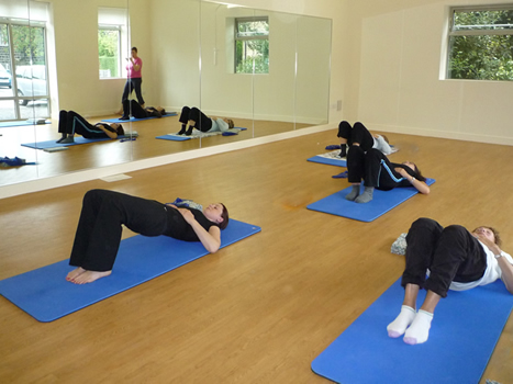 Large and small group Pilates class